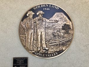 Founders of Apple Valley on crest showing Golden Land of Apple Valley 1946
